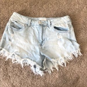 Cheeky frayed shorts